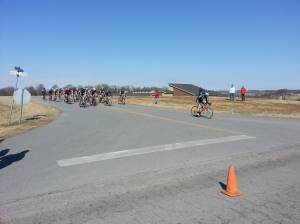The main group of the Men's B criterium hosted by Lindsey Wilson College on Feb. 22. chases an early break away after cresting the hill.
