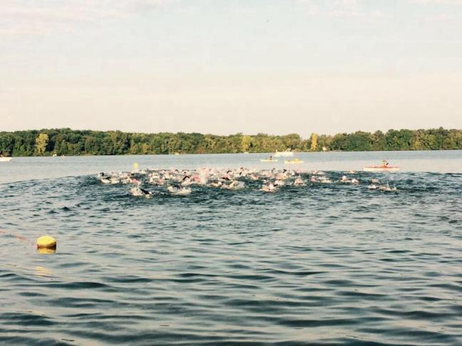 The 96-strong collegiate field in the water.